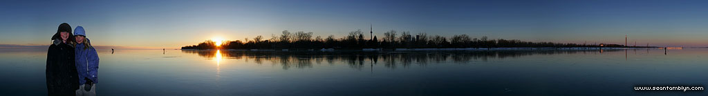 Panorama of Toronto Islands and skyline reflected in perfect black ice, Toronto Outer Harbour, Toronto Islands