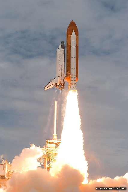 STS-135 space shuttle Atlantis launch clearing the tower