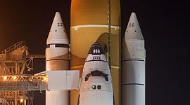 STS-133 space shuttle Discovery on the launch pad after RSS rollback
