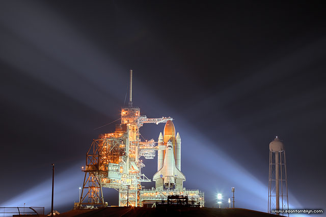 Space shuttle Endeavour, STS-134, light by xenon lights on the launch pad at night