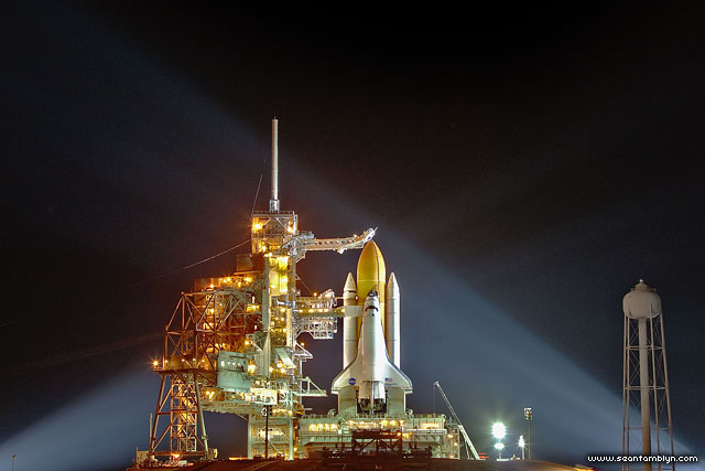 STS-133 space shuttle Discovery illuminated by Xenon lights on the launch pad