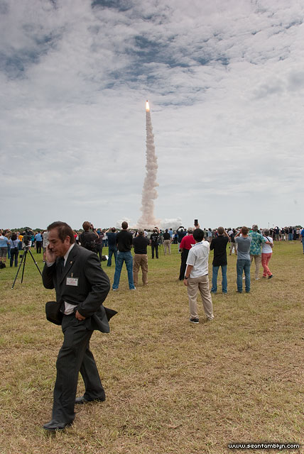 Gentleman on cell phone, final launch of space shuttle Atlantis, STS-135