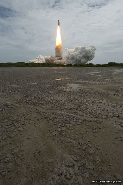Final launch of space shuttle Atlantis, STS-135, over a dry lake bed
