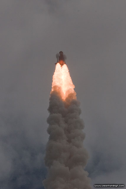 Condensation cones around space shuttle Atlantis' Solid Rocket Boosters, STS-135