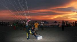 Skydiver grabbing bottle of beer panorama, Puerto Escondido, Mexico